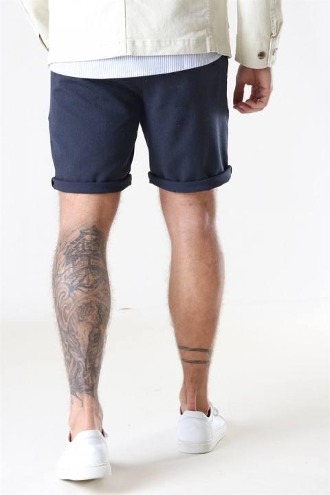 Woodbird Steffen Mel. Shorts Navy Mel.